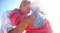 Elderly active seniors hugging on the beach video