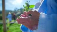 elderly citizen with flower in her hands video