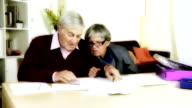 Elderly couple calculating domestic bills at home video