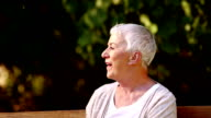 Elderly couple on a park bench video