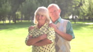 Elderly couple on park background. video