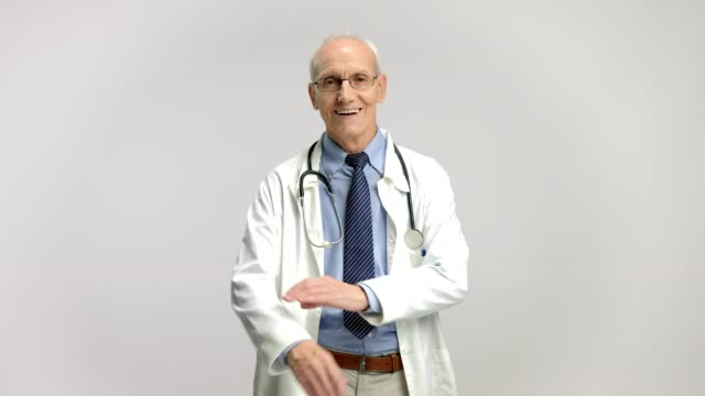 Elderly doctor smiling and crossing his arms video