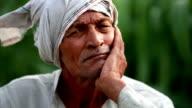 Elderly farmer man lost in thought video