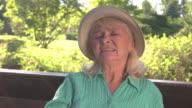 Elderly lady has headache. video