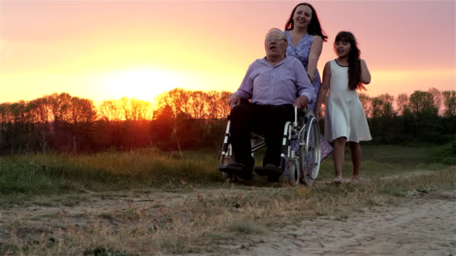 Elderly Man In a Wheelchair With Family video