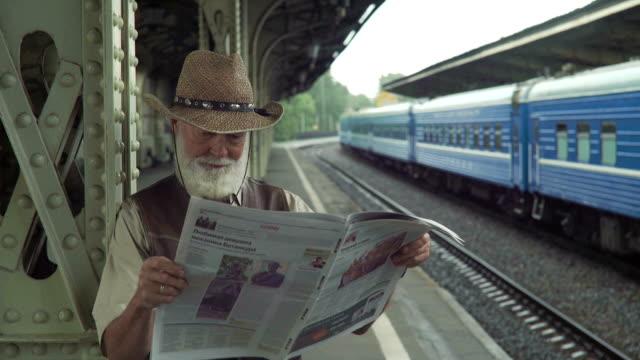 Elderly Man Reading Newspaper video