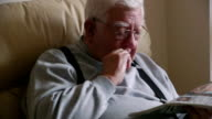 Elderly Man Relaxing with his Newspaper video