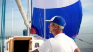 Elderly man sailor on sailboat, yachting, vacation, traveling video