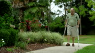 Elderly Man With Crutches video