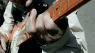 Elderly musician playing guitar. video