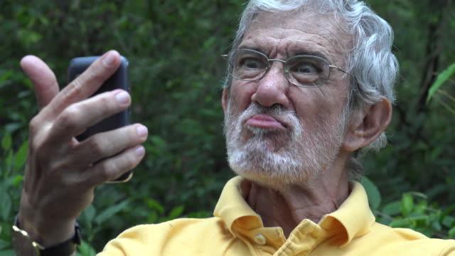Elderly Old Man Taking Selfie video