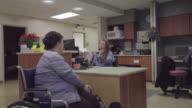 Elderly Patient Doing Paperwork In Hospital video