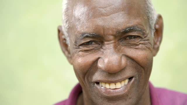 Elderly people portrait, happy old black man smiling at camera video