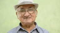 Elderly people portrait, happy old man with hat and eyeglasses video
