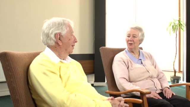 Elderly people talking whilst sat in Armchairs video