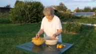Elderly woman 80s cleans chanterelle mushrooms video
