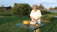 Elderly woman 90s cleans chanterelle mushrooms video