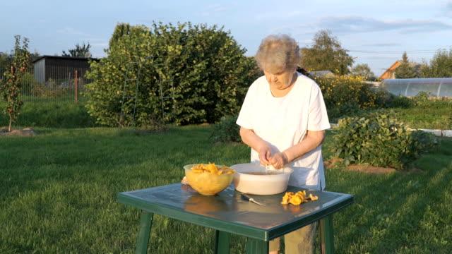 Elderly woman 90s cleans chanterelle mushrooms video