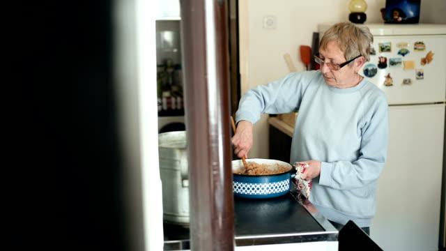 Elderly woman cooking video