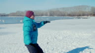 Elderly woman doing gymnastics on a background lake with swans video