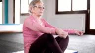 Elderly woman doing yoga video