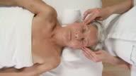 HD CRANE: Elderly Woman Enjoying Facial Massage video