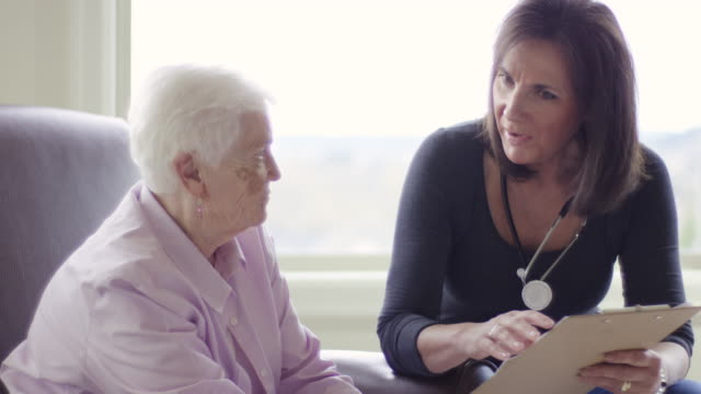 Elderly woman getting care in a home healthcare setting video