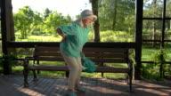 Elderly woman has backache. video