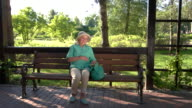 Elderly woman holding her stomach. video