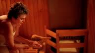 Elderly woman in Sauna video