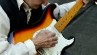 Elderly woman playing guitar. video