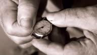 Elderly woman setting wrist watch. video