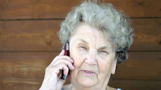 Elderly woman talking on the cell phone video