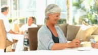Elderly womens playing cards video