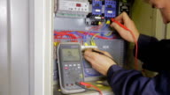 Electric Breaker Box. Electrician testing and switching fuse, breaker in a fuse box video