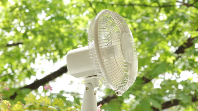 Electric fan on nature background video
