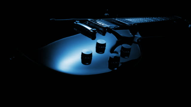 Electric Guitar On Black Background. Tracking Shot video