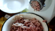 Electric meat grinder grinds meat for minced meat close up view video