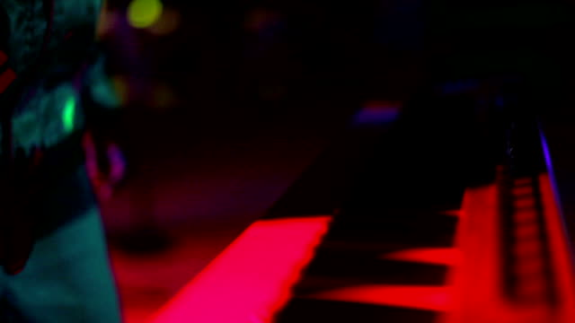 Electric piano in nightclub video