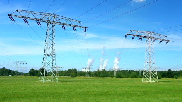 Electric pylons in front of two coal power stations video