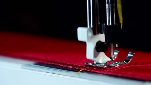 Electric sewing machine embroider on fabric. Sewing needle stitching on fabric video