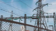 Electric support behind the fence of the power plant. Power and the electrical industry. Production and transportation of electricity by wire video