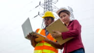 HD CRANE : Electric worker and engineer discuss with laptop and clipboard video