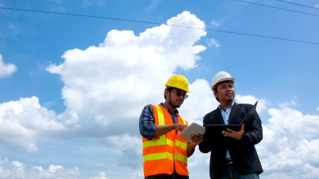 Electrical engineer inspects a project's progress with digital tablet video