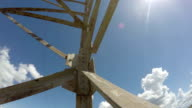 Electrical pylon against blue cloudy sky, time lapse video