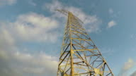 Electrical pylon on sunny cloudy evening, time lapse video