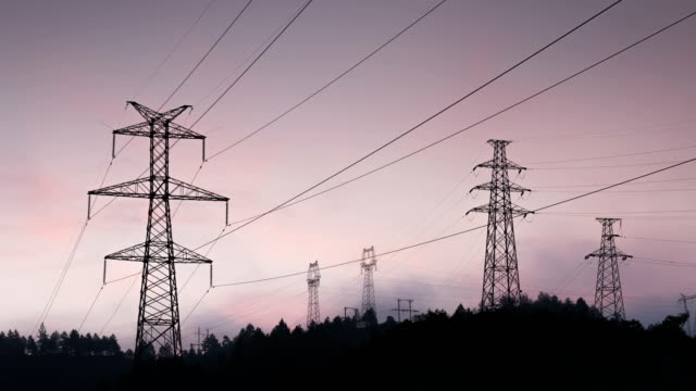 Electrical Pylons at sunrise 4K Time Lapse Video video