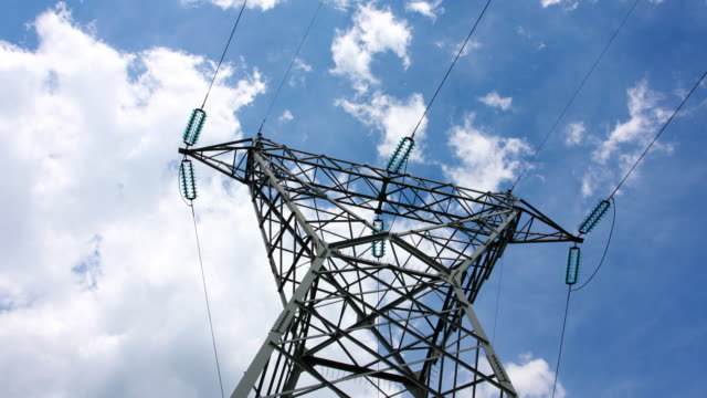 Electrical tower with cloudscape video