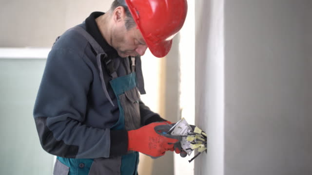 Electrician installing light switch. video