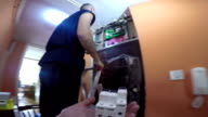 Electrician Installing the Automatic Circuit Breakers at Power Control Panel video
